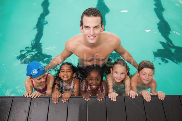 Cute nuoto classe piscina coach tempo libero Foto d'archivio © wavebreak_media