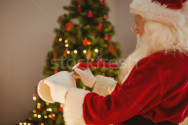 Santa claus writing with a quill Stock photo © wavebreak_media