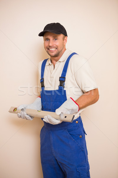 Confused construction worker holding spirit level Stock photo © wavebreak_media