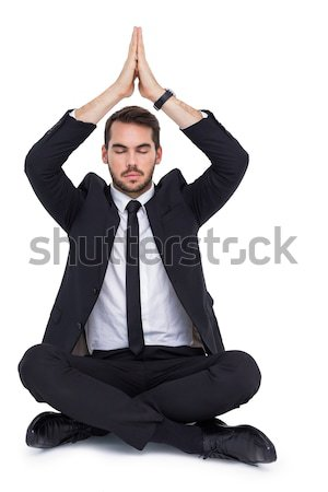 Calm businessman sitting in lotus pose with hands together Stock photo © wavebreak_media