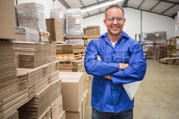 Glimlachend magazijn manager permanente groot Stockfoto © wavebreak_media