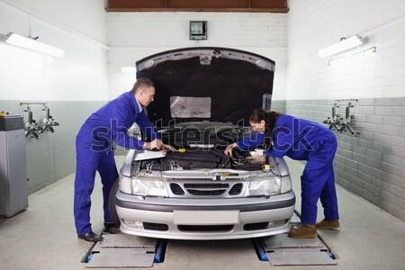 Mechanic vacuuming the car interior Stock photo © wavebreak_media