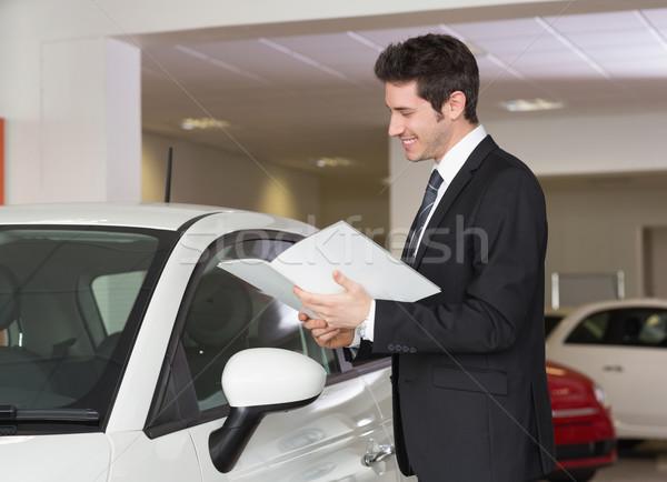 Businessman reading over a booklet Stock photo © wavebreak_media