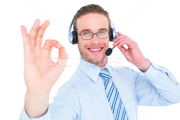 Empresario auricular bueno signo blanco Foto stock © wavebreak_media