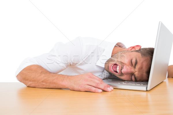 Businessman screaming put his head on laptop Stock photo © wavebreak_media