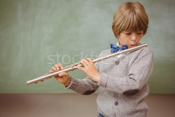 Mały chłopca gry flet klasie portret Zdjęcia stock © wavebreak_media