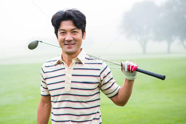 Golfçü ayakta kulüp gülen kamera Stok fotoğraf © wavebreak_media