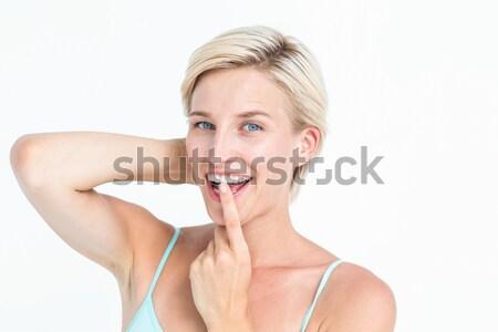 Pretty blonde woman ready to swallow red pill Stock photo © wavebreak_media
