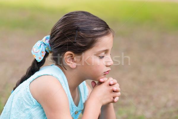 Little girl saying his prayers Stock photo © wavebreak_media