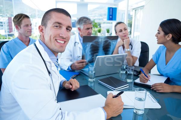 Team of doctors working on laptop and analyzing xray Stock photo © wavebreak_media