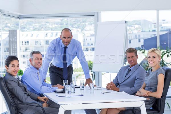ストックフォト: 幸せ · ビジネスの方々 · 見える · カメラ · オフィス · 会議