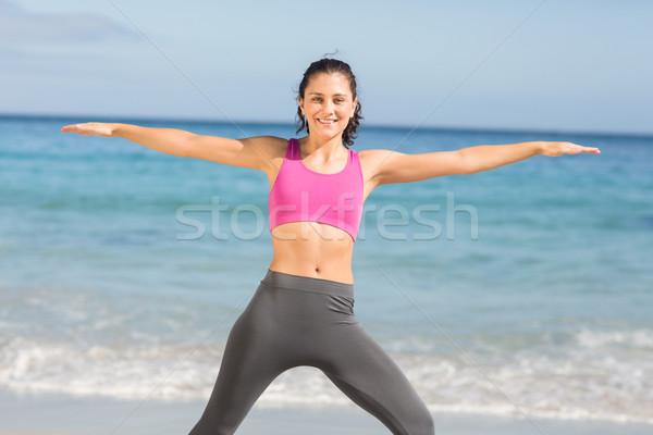 Fit woman doing fitness beside the sea  Stock photo © wavebreak_media