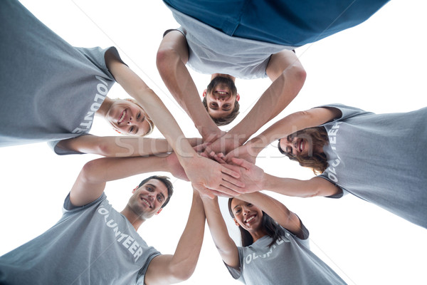 Volunteers putting their hands together Stock photo © wavebreak_media