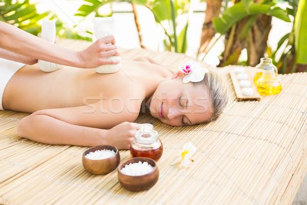 Mulher atraente massagem de volta atraente mulher jovem estância termal Foto stock © wavebreak_media
