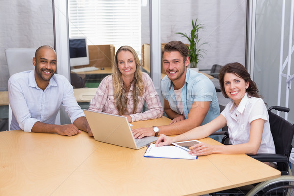 Group of business people using tablet computer and laptop Stock photo © wavebreak_media
