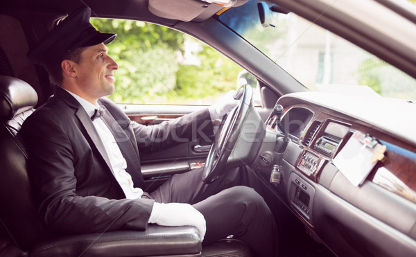 Limousine driver driving and smiling Stock photo © wavebreak_media