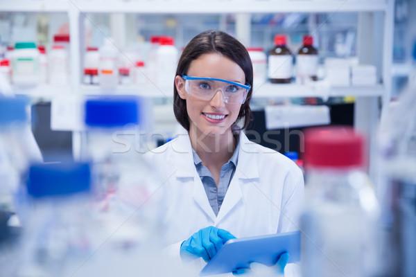 Uśmiechnięty chemik okulary ochronne laboratorium Zdjęcia stock © wavebreak_media