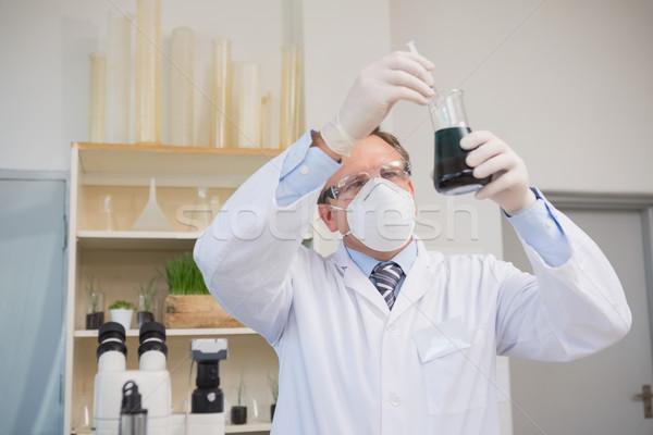 Scientist doing experimentations in flask  Stock photo © wavebreak_media
