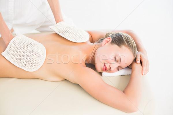 Peaceful blonde enjoying an exfoliating back massage Stock photo © wavebreak_media