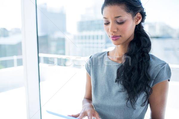A focused businesswoman using digital tablet Stock photo © wavebreak_media