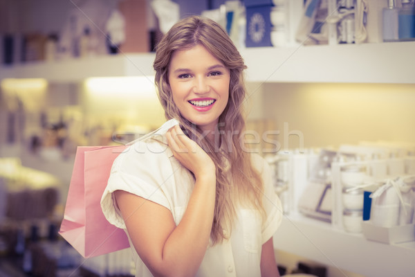 Joli femme blonde parfumerie Mall Homme souriant Photo stock © wavebreak_media