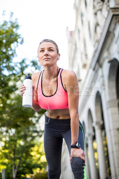 A beautiful woman holding a bottle of water  Stock photo © wavebreak_media