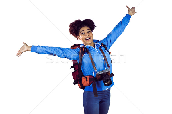 Ecstatic young woman with arms in the air Stock photo © wavebreak_media