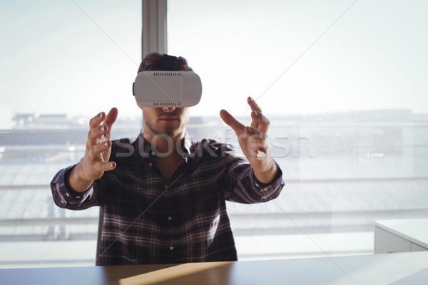 Businessman using virtual reality headset in creative office Stock photo © wavebreak_media