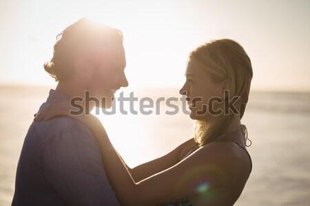 Happy young couple embracing at beach Stock photo © wavebreak_media