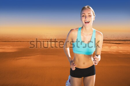 Rear view of woman with hand on hip at beach Stock photo © wavebreak_media