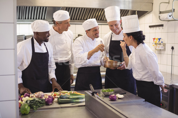 Team of chef tasting food in the commercial kitchen Stock photo © wavebreak_media
