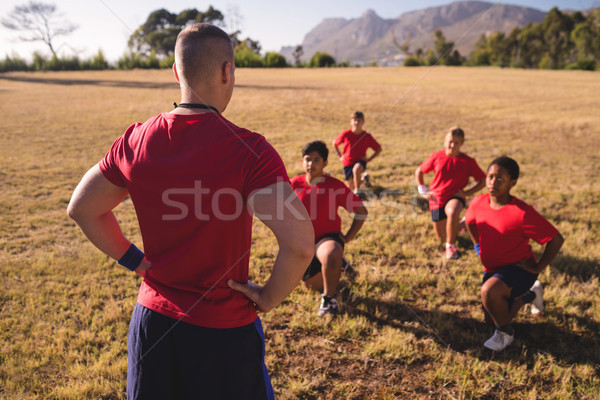 Trainer instructing kids while exercising in the boot camp Stock photo © wavebreak_media