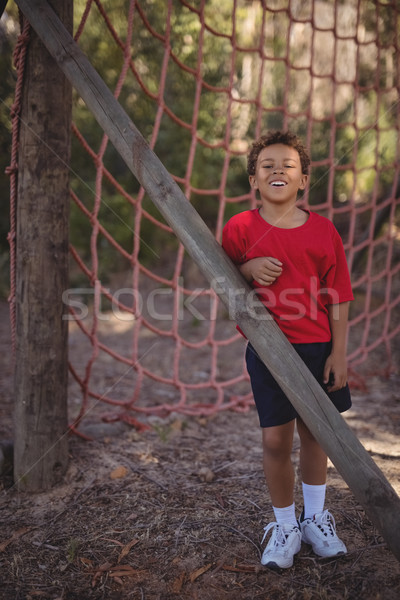 Stock photo: Portrait of happy boy standing near net during obstacle course