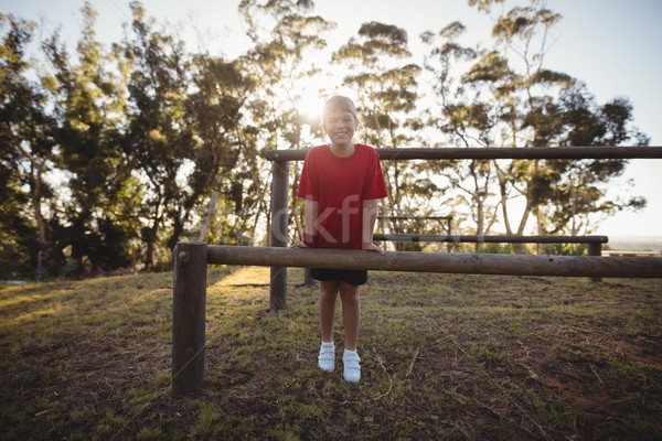Portrait of happy girl standing near obstacle Stock photo © wavebreak_media