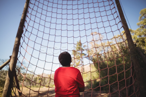 Rear view of kid looking at net during obstacle course Stock photo © wavebreak_media