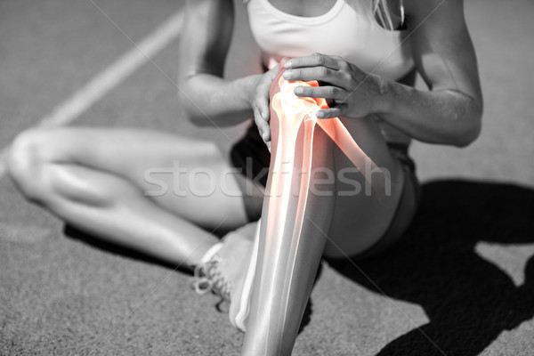 Low section of athlete suffering from knee pain Stock photo © wavebreak_media