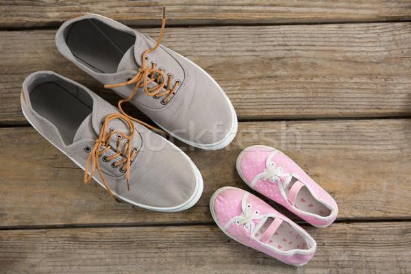 Overhead view of shoes and baby booties on floor Stock photo © wavebreak_media