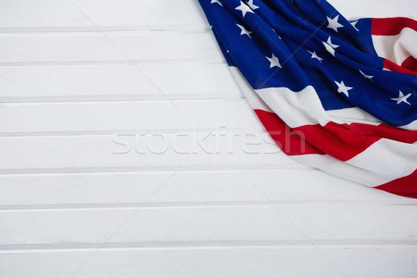 Primo piano bandiera americana legno alimentare tavola blu Foto d'archivio © wavebreak_media