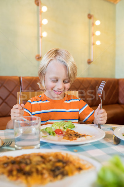 Boy having food in restaurant Stock photo © wavebreak_media