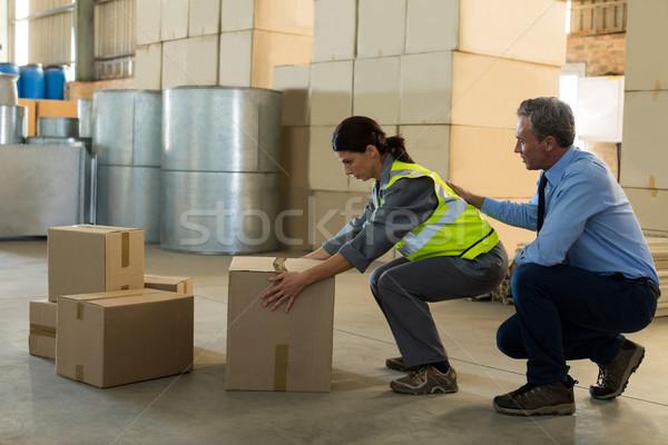 Manager vrouwelijke werknemer werken fabriek man Stockfoto © wavebreak_media