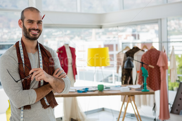 Portrait of smiling designer with arms crossed in workshop Stock photo © wavebreak_media