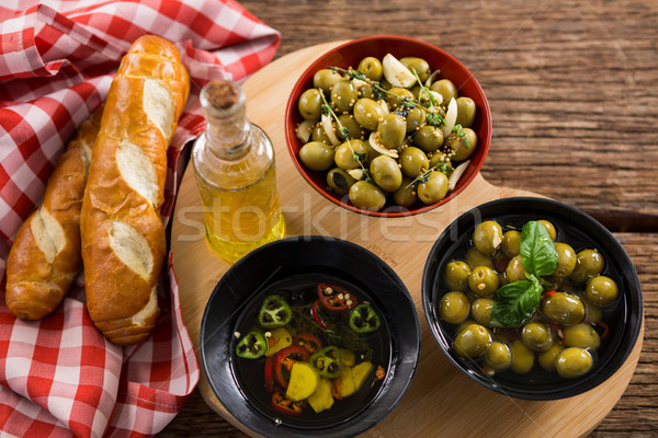 Marinated olives, bread and olive oil on heart shape board Stock photo © wavebreak_media