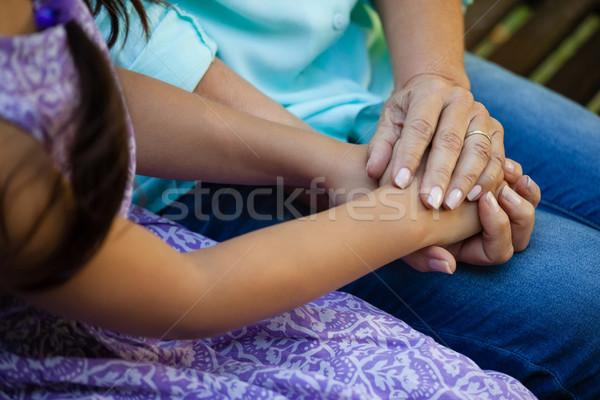 Idős nő kéz a kézben nagymama udvar lány Stock fotó © wavebreak_media