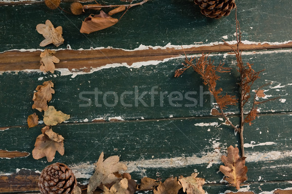 Overhead view of dried leaves and pine cone arranged on wooden table Stock photo © wavebreak_media