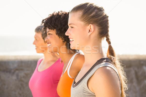 Smiling sporty women looking far away Stock photo © wavebreak_media