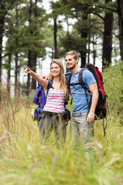 Young hiker couple pointing Stock photo © wavebreak_media