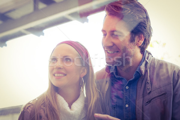 Smiling couple looking and pointing at window Stock photo © wavebreak_media