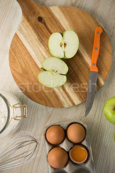 Overhead view of granny smith apple halved on cutting board Stock photo © wavebreak_media