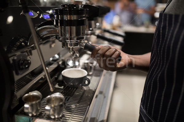 Mid section of waiter making cup of coffee Stock photo © wavebreak_media