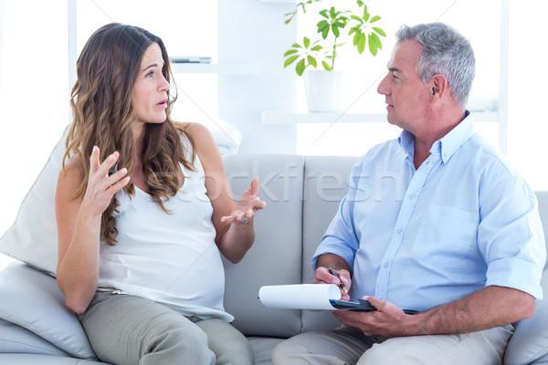 Psychiatrist listning pregenat woman in clinic Stock photo © wavebreak_media